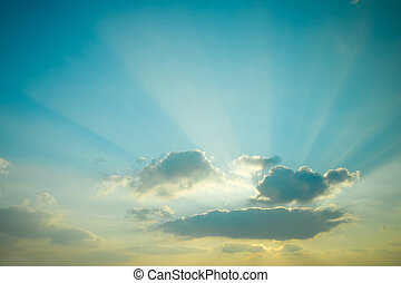 Sunset. Beautiful sun rays scattered clouds.