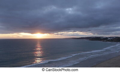 Sunset before storm, with a cloudy sky. Beach Falesia