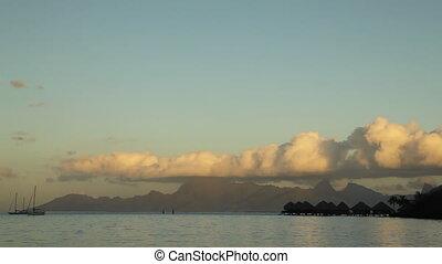 Moorea Island - Sunset behind Moorea Island Mountains seen...