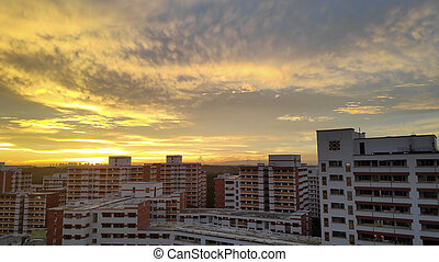 Sunset behind row of apartments in Singapore