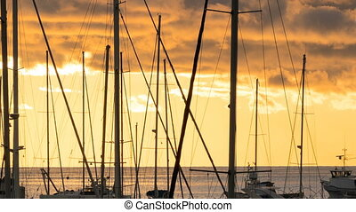Sunset behind the yachts at marina in Bar city, Montenegro