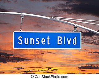 Sunset Blvd overhead street sign with sunset sky.
