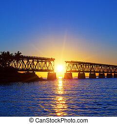 Sunset bridge - Colorful sunset with famous broken bridge,...
