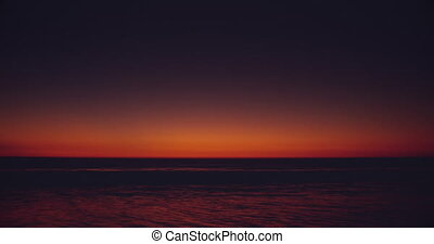 Sunset by the sea - View of a colored sunset at an empty ...