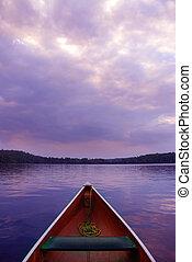 Sunset canoe - boat at sunset on lake