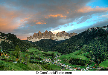 Sunset clouds above Funes Valley in northern Italy - Sunset ...