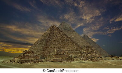 sunset clouds over pyramids at Giza, Egypt