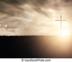 Sunset Cross - A Christian cross at sunset with light...
