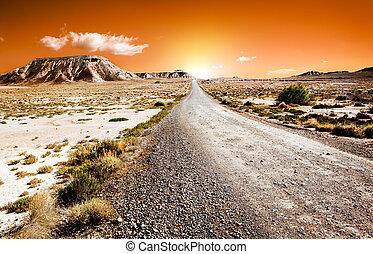 Sunset desert landscape with road