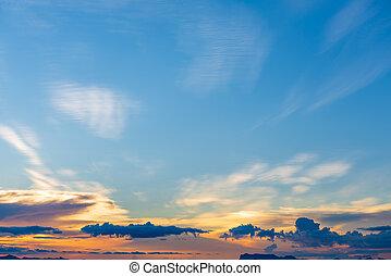 Sunset dramatic blue sky orange clouds background
