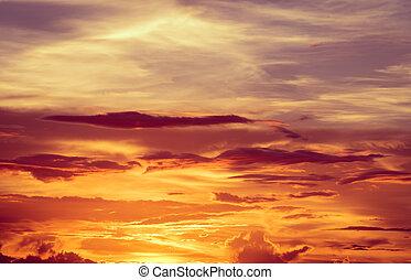 Sunset dramatic orange clouds sky background