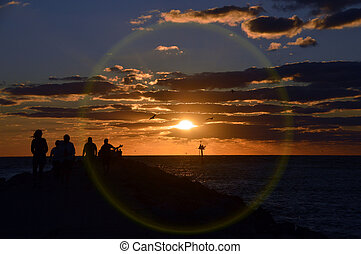 Sunset encircled - This is a photo of a crowd watching the...