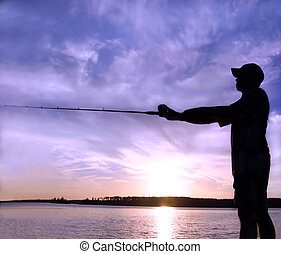 Sunset Fishing - Silhouette of a man fishing in a sunset