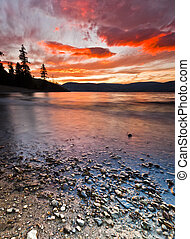 Sunset from Shore of Scenic Mountain Lake in Summer