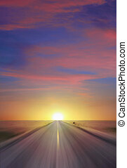 Sunset Highway - Sun setting at thte end of a straight two...