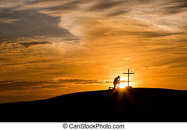 Sunset Hill Praying Cross - Sunset behind a man praying next...