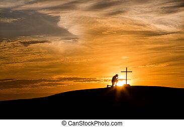 Sunset Hill Praying Cross - Sunset behind a man praying next...