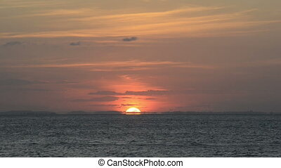 Sunset Horizon - Sun setting as a ball of fire on the...
