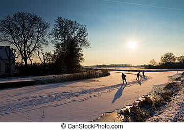 Sunset ice skating - Ice skating in a beautiful snowy...
