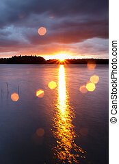 Sunset image with lens flare
