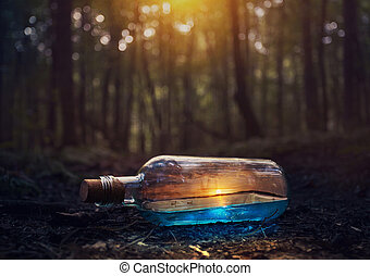 Surreal image of a glass bottle that contains a beautiful sunset over the ocean.