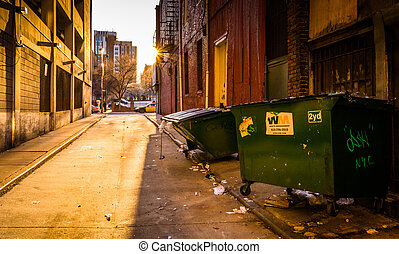 Sunset in a dirty alley in Baltimore, Maryland.