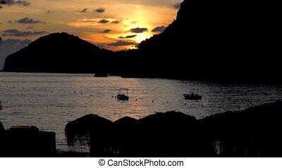 Sunset in a sea bay with boats. Time lapse - Sunset in a...
