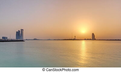 Sunset in Abu Dhabi over Marina Island timelapse, view from...
