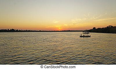 Sunset in Africa - Sunset on the Zambezi River in Zambia,...