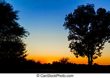 Sunset in Africa. - Picturesque sunset over the rural...