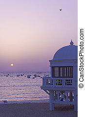 Sunset in Atlantic ocean. Cadiz, Spain.