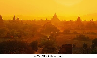 Sunset in Bagan - Tourists taking cart ride to watch...