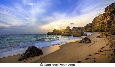 sunset in beautiful beach Praia da Marinha - Algarve, Portugal