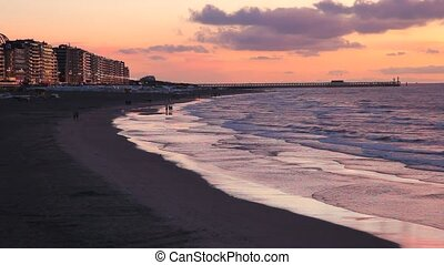 Sunset in Blankenberge - Sunset at the North Sea beach in...