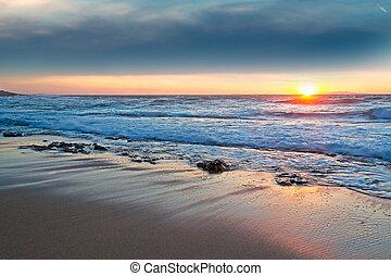 scenic sunset in Castelsardo sandy shore