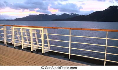 Sunset in Chilean Fjord - Deck railing of cruise ship in the...
