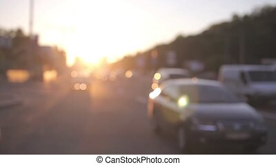 Sunset in city with beautiful bokeh and sun backlight.