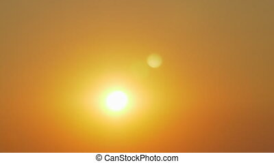 Sunset in clear sky - Slow motion shot of sun shining in...
