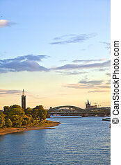 sunset in cologne with Dome and river Rhine