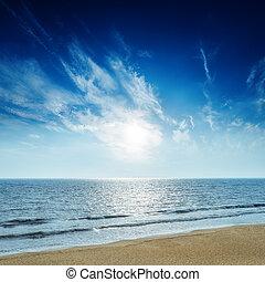 sunset in deep blue sky over sea