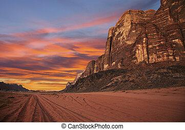 Sunset in desert - Mountains during sunset in Wadi Rum,...