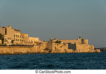 Sunset in Embankment of Ortygia island and Castello Maniace , Syracuse city, in Sicily.
