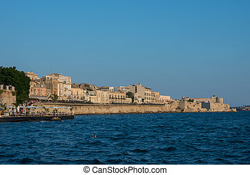 Sunset in Embankment of Ortygia island, Syracuse city, in Sicily.