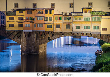 Sunset in Florence, Ponte Vecchio bridge across Arno River, Tuscany - Italy