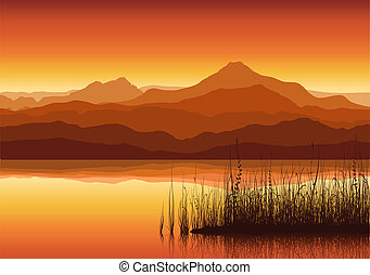 Sunset in huge mountains near lake with grass