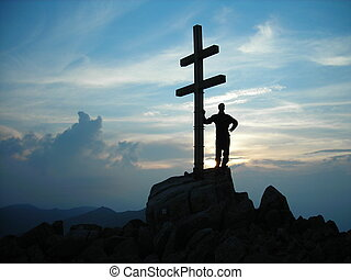 Sunset in mountain with cross