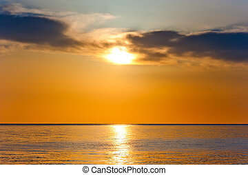sunset in orange tones over a calm sea