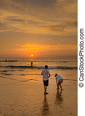 Phuket Young people are photographed against the backdrop of the sunset sky