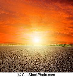 sunset in red sky over desert