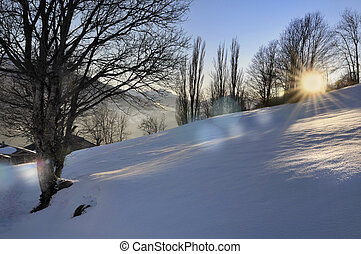sunset in scenic landscape in winter